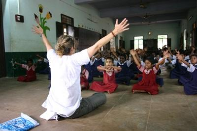 Female volunteer doing activities with kids in India, Asia