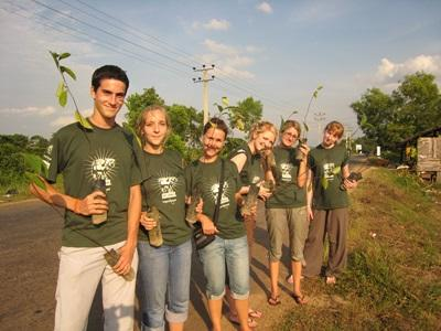 A group of volunteers with trees in a conservation project in India