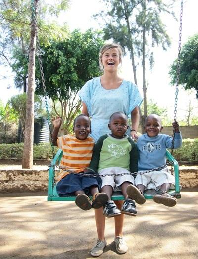 Female volunteer with children in a care project in Kenya