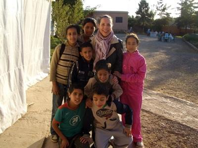 A volunteer spending time outside with some kids from the Care centre in Morocco