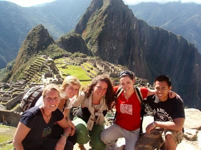 A group of volunteers at Machu Picchu having fun in their leisure time in Peru