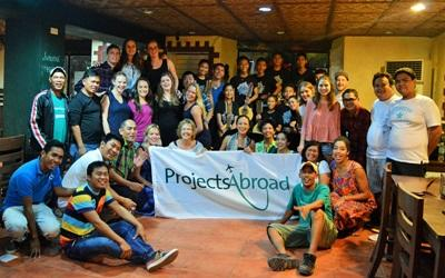 A group of Projects Abroad Philippines volunteers pose for a photo at the office