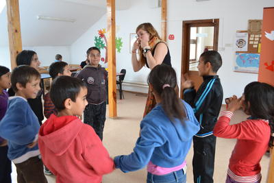 Projects Abroad volunteer playing educational games at her placement in Romania