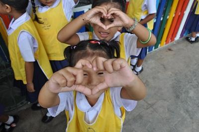 Children making hearts at care project in Thailand, Asia