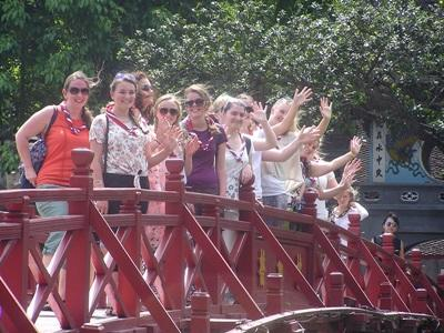 Community volunteers from Ambleside Guide group in the UK, visit the temple on Hoan Kiem Lake.